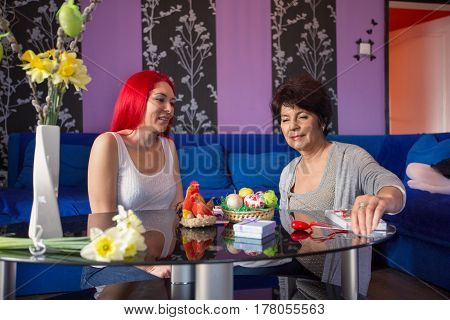 Happy together - mother and adult daughter at home