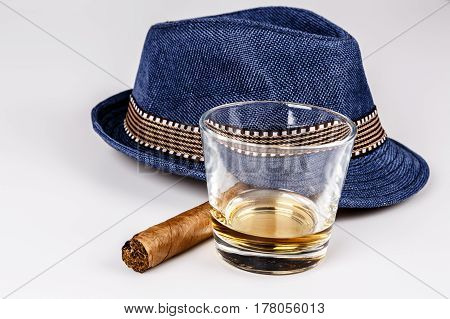 Blue Hat With Cigar And Expensive Drink Of Whisky Or Rum On White Floor