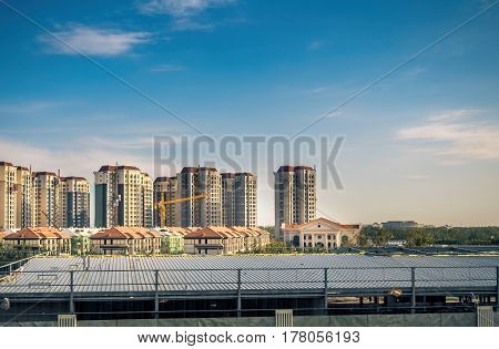 Beijing, China - Oct 31, 2016: Construction of residential houses and high-rise apartments. Scene captured from within a High-Speed Rail (HSR) bullet train traveling at 300 km/h.
