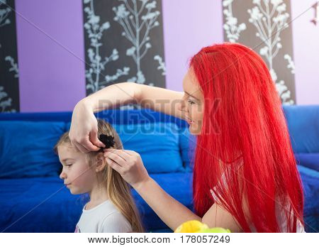 Mom and young daughter at home having fun