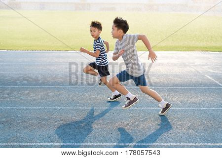 Boy Running On The Blue Track