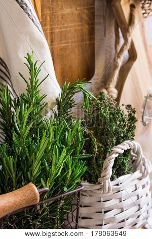 Provence rustic interior fresh herbs wood cutting board linen towel glass bottles baskets pantry style soft daylight