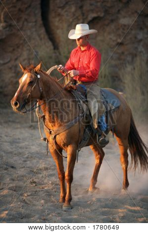 Cowboy And His Horse At Dusk