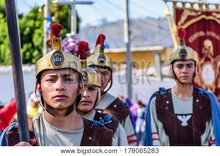 Antigua, Guatemala - March 19 2017: Locals dressed up as Romans in Lent procession in colonial town with most famous Holy Week celebrations in Latin America.