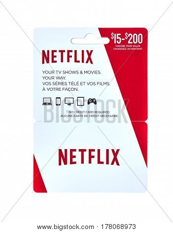 MONTREAL CANADA - MARCH 10 2017 : Netflix popular giftcard. The card is a prepaid stored-value money card issued to be used as an alternative to cash for purchases.