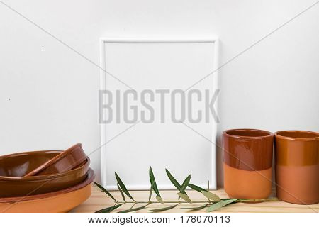 Frame mockup collection of terracotta glazed earthenware on wood table olive tree branch styled image for product marketing online store