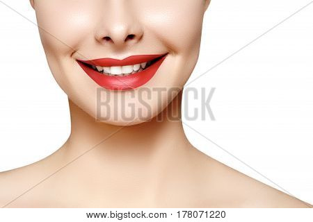Wide smile of young beautiful woman with perfect healthy white teeth on white background. Dental whitening ortodont care tooth and wellness. Red lipstick makeup on female lips.