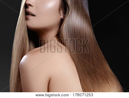 Fashion long hair. Beautiful brunette girl. Healthy straight shiny hair style. Beauty woman model. Shine smooth hairstyle. Keratin treatment