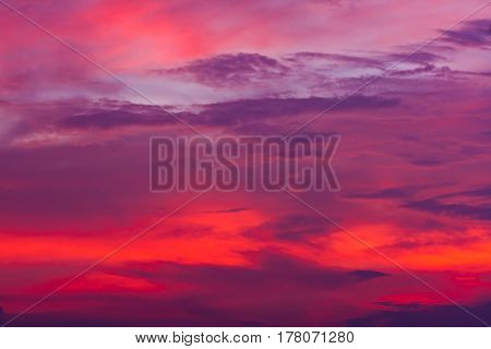 Nature background. Red sky at night and clouds. Beautiful and colorful sunset or sunrise time. Outdoors on summer day in the evening or in the morning.