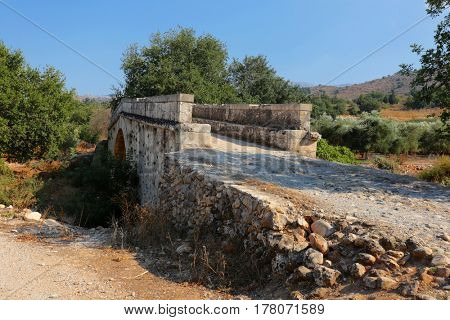 Historic 19th Century Koutsos Bridge near Vrises in the Apokoronas area of central Crete, Greece. It was built to serve an adjacent mill.