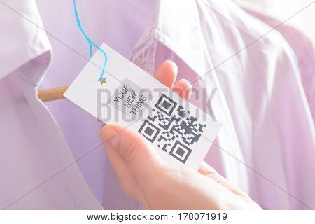 Woman's hands with a qr code label in a shop