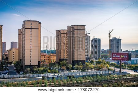 Beijing, China - Oct 31, 2016: Newly constructed residential high-rise apartments. More being constructed. Scene captured from within a High-Speed Rail (HSR) bullet train traveling at 300 km/h.