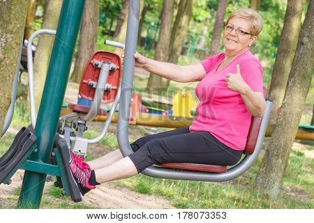 Senior Woman Exercising Lower Body On Outdoor Gym, Healthy Lifestyle