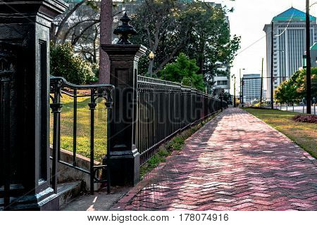 Montgomery Alabama USA - March 18 2017: Sidewalk along Monroe Street at the base of Capitol Hill with RSA Tower visible in the background.