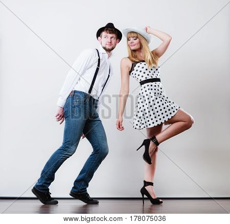 Young Happy Couple Dancing