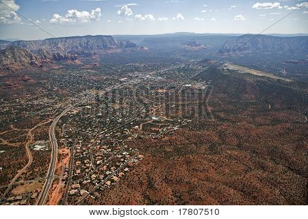 A lovely aerial view of Sedona, Highway 89a and the airport poster