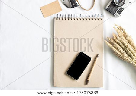 flat lay workspace desk with stationery sunglass and blank notebook with copy space background minimal styled