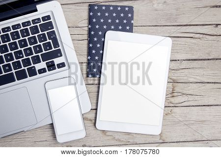 modern office desk with tablet, handy and notepad