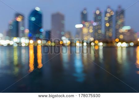 Abstract blurred bokeh light city office building water front and reflection background