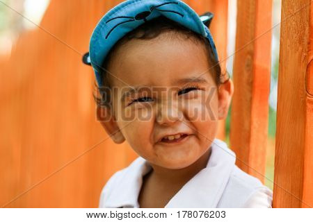 Closeup portrait of a two-year-old boy. Outdoor