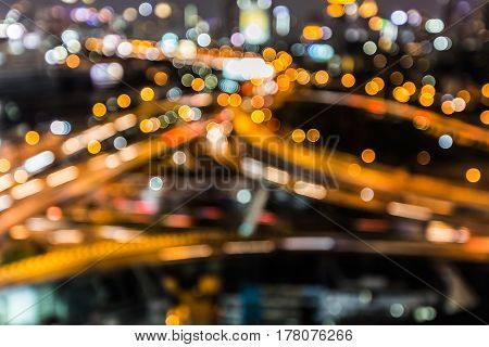 Aerial view blurred bokeh light Highway interchanged night view abstract background