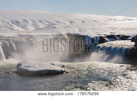 Godafoss waterfall with clear blue sky background Iceland natural winter landscape background