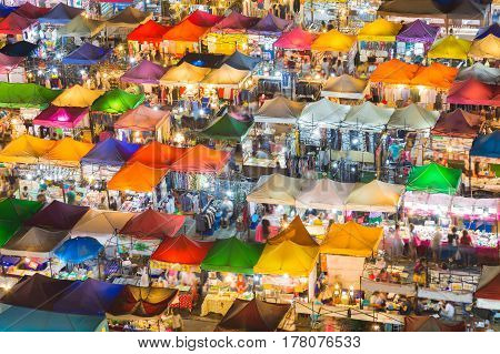 Multiple colour night market roof top multiple colour cityscape background