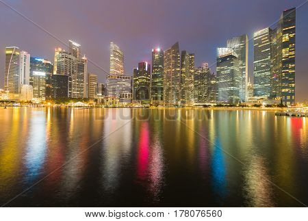 Singapore central business downtown light night view sea front cityscape downtown background