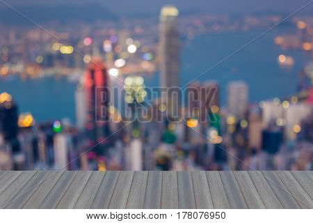 Opening wooden floor Hong Kong city blurred bokeh light aerial view abstract background