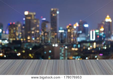 Opening wooden floor Night light blurred bokeh city office building abstract background