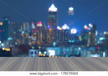Opening wooden floor Abstract blurred lights office building with clear blue sky background