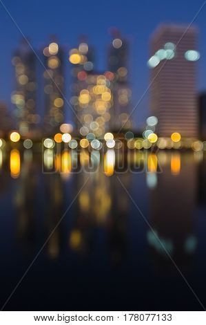 Twilight office building blurred bokeh light and reflection abstract background
