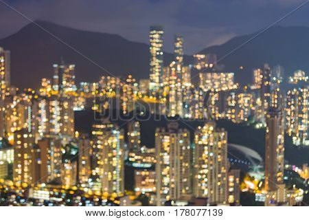 City apartment blurred bokeh light night view Hong Kong city downtown abstract background