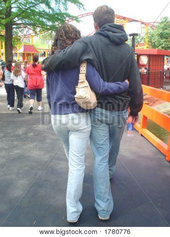 Loving Couple At The Amusement Park
