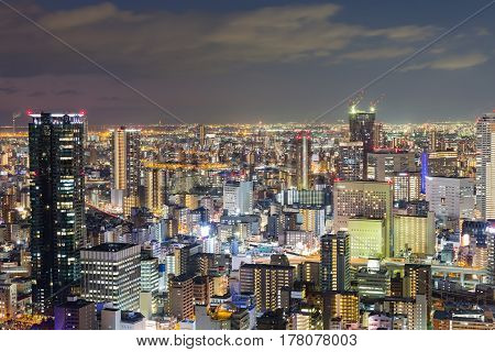 Night lights Osaka central business downtown aerial view Japan
