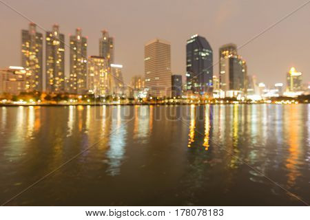 City blurred bokeh light night view water front abstract background