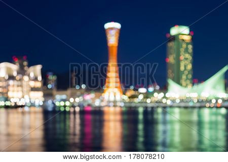Night blurred light Kobe port tower with reflection with blue sky background