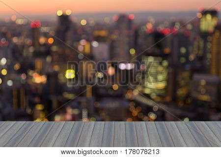 Opening wooden floor aerial view blurred bokeh light office building business downtonw abstract background