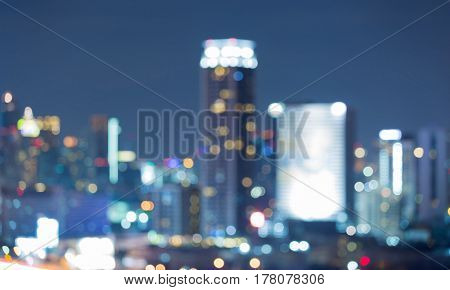 Abstract blurred bokeh office building with twilight sky abstract background