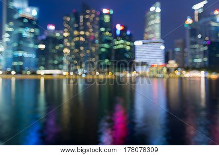 Night blurred bokeh light Singapore central business downtown abstract background