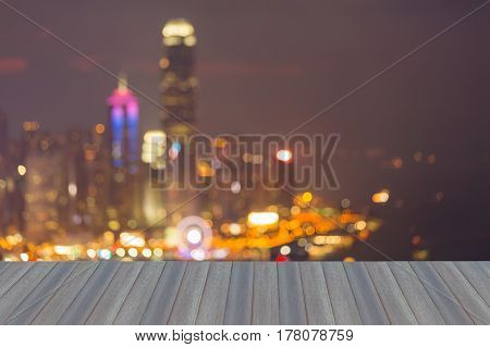 Opening wooden floor City of Hong Kong blurred bokeh light abstract background