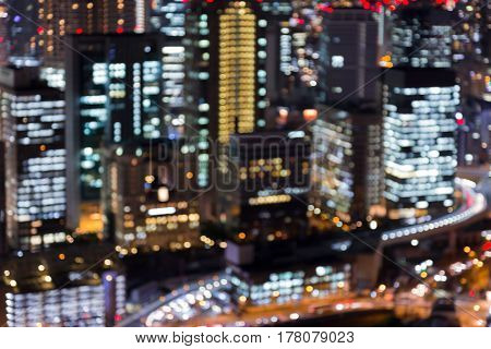 Close up blurred bokeh lights office building night view abstract background