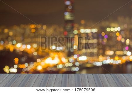 Opening wooden floor Blurred bokeh light Hong Kong city over Victoria Bay abstract background