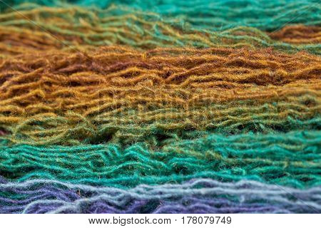 Multi-colored wool yarn for knitting. Horizontally arranged threads