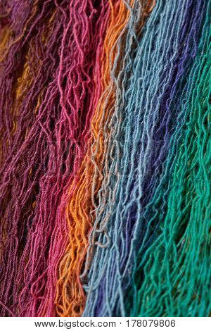 Multi-colored wool yarn for knitting. Vertically arranged threads.