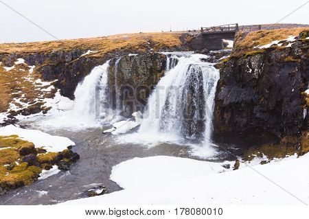 Iceland nature winter waterfall during late winter season natural landscape background