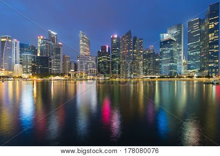 Twilight Singapore office building central business downtown sea front cityscape downtown background
