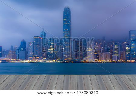 Opening wooden floor Blurred bokeh light Hong Kong city sea front abstract background
