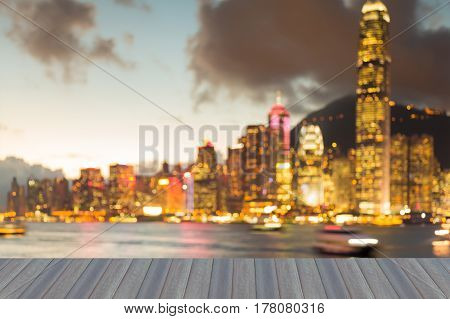 Opening wooden floor City of Hong Kong blurred light night view abstract background