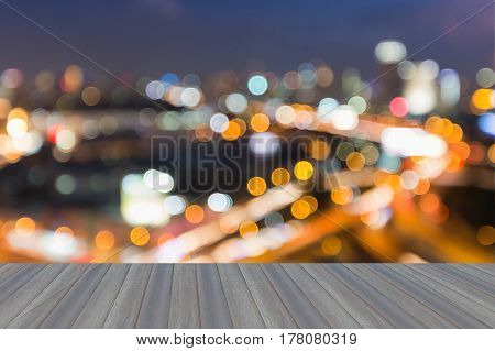 Opening wooden floor Night blurred bokeh city road curved aerial view abstract background